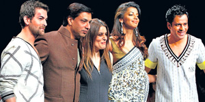 Director Madhur Bhandarkar and actors Neil Nitin Mukesh, Mugdha Godse and Manoj Bajpai on the ramp for designer Mynah Reynu Tandon at the Wills Lifestyle India Fashion Week in New Delhi on Tuesday. PTI