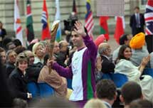 Olympic gold medallist shooter Abhinav Bindra walks with the 'Queen's Baton' during the relay ceremony at London's Buckingham Palace on Thursday.