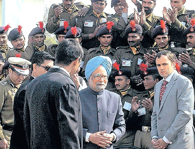 Prime Minister Manmohan Singh, Jammu and Kashmir Chief Minister Omar Abdullah and  Union Minister Prithviraj Chauhan interact with CRPF  jawans at the CRPF base camp in Srinagar on Thursday. PTI