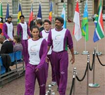 Indian sports stars Sania Mirza and Kapil Dev walk during Queen's Baton relay ceremony.