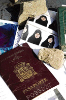 Seized photos and an alleged Spanish passport of Raquel Garcia Burgos at the Sherwangi Tor village in south Waziristan on Thursday. AFP