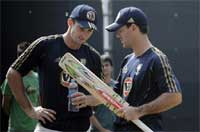 Australian cricket captain Ricky Ponting, right, talks to teammate Shaun Marsh during a net session, a day ahead of the third one-day match against India in New Delhi. PTI