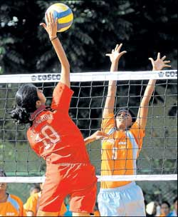 SAI's Chaitra (left) smashes past KSP's Shaila during their 'A' division clash in Bangalore on Friday. DH photo