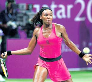 US' Venus Williams makes a forehand return to Svetlana Kuznetsova of Russia in the WTA Championships in Doha on Thursday. AFP