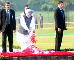 Prime Minister Manmohan Singh pays homage to former Prime Minister Indira Gandhi on her 25th death anniversary in New Delhi on Saturday. AFP