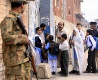 Pakistan army soldier stands guard outside a local school in Peshawar, Pakistan, on Monday, Nov. 2, 2009. Authorities increased security around schools after a suicide bomb attack on the Islamic university in the capital, the latest in a series of terror attacks in the city. (AP)