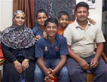 Sarfaraz Khan (C) along with his family at his residence in Mumbai on Friday.