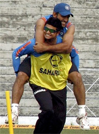 Indian cricketers M S Dhoni and Suresh Raina at Guwahati during practice match. PTI