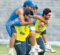 Riding piggyback: Suresh Raina, MS Dhoni, Yuvraj Singh and Virat Kohli in a playful mood during India's practice session in Guwahati on Saturday. AP