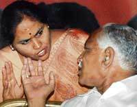 In happier times Chief Minister B S Yeddyurappa and his cabinet colleague Shobha Karandlaje whom the dissidents are targeting. PTI Photo