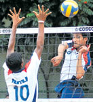 Brute force: ITI's Sharadh Shetty smashes even as HMT's Sunil goes for a block in the 'A' division volleyball tournament in Bangalore on Saturday. DH photo
