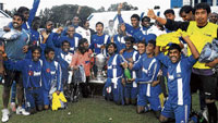 in high spirits: BEML players celebrate their Puttaiah Memorial Cup victory over MEG on Sunday. dh photo