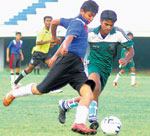 Surging ahead: Rohith K of Jyoti Kendriya Vidyalaya (left) moves past Rakshith of  Sheshadripuram College in the inter-collegiate football tournament on Monday. DH photo