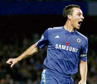 Chelsea's John Terry exults after scoring against Manchester United in the Premier League clash on Sunday. AP
