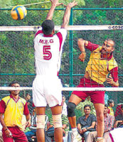 Breaking through: Viswanath of Jindal smashes past Prince of MEG during their Super League clash on Monday. DH photo