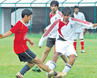 Keen tussle: Vijay of SBMJCE (left) and BIT's Girish battle   for possession on Tuesday. DH photo
