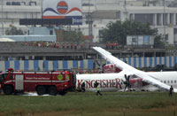 narrow escape: Rescue operation is under way after a Kingfisher Airlines aircraft overshot the runway on landing in Mumbai on Tuesday. AP