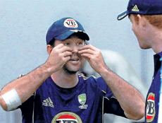 Very cheeky!: Australian skipper Ricky Ponting has a bit of fun during Tuesday's training session at the DY Patil stadium in Mumbai. PTI