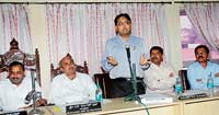 KUIDFC Managing Director Aravind Srivastav speaking at an MCC meeting in Mangalore on Wednesday. DH photo