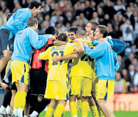 Giant-killers: Players of Spanish third division team Alcorcon celebrate after knocking Real Madrid out of the King's Cup in Madrid on Tuesday. AFP
