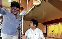 KSRTC Vice-President Jaggesh and Transport Minister R Ashok at the launch of Ambari sleeper bus in Bangalore on Friday. DH PHOTO
