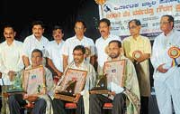 Ibrahim Thanneerbavi, U A Kasim Ullal and Muhammed Kulai with their awards at a function organised by  Karnataka Beary Sahitya Academy  in Mangalore on Friday. DH photo