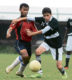 FIERCE BATTLE Cathedral College's Sherwin (right) and Shome of IISc battle for possession on Saturday. DH photo
