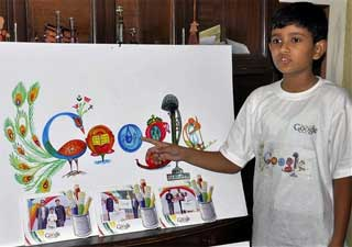 Nine year old Puru Pratap Singh with his design of Google's home page at his residence in Gurgaon on Friday. PTI