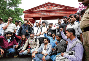 Media protest after lawyers attack a TV cameraman at the Karnataka High Court.