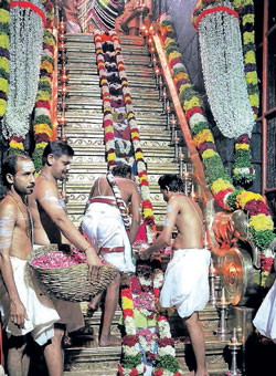Priests decorate the steps of Lord Ayyappa Temple as part of the Padipuja at Sabarimala in Kerala on Saturday. PTI