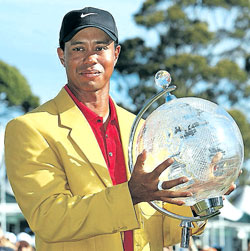 Tiger Woods shows off his spoils after winning the Australian Masters golf tournament. AFP