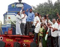 Stoppage of Basava and Prashanti Express at Gauribidanur railway station, as per the order of Central government, on Sunday was witnessed by MLA N H Shivashankar Reddy. dh photo