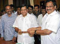 Jagadish Shettar submitting his resignation letter to Deputy Speaker K G Bopaiah in Bangalore on Monday.