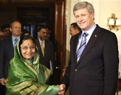Indian President Pratibha Patil, left, shakes hand with Canadian Prime Minister Stephen Harper at the Rashtrapathi Bhavan in New Delhi, on Tuesday. Harper is on an official four-day long visit to India. AP