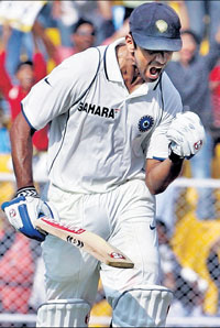 Indian cricketer Rahul Dravid exults after scoring a century during India's first innings on the first day's play of the first Test between India and Sri Lanka in Ahmedabad on Monday. AP