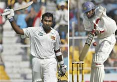 Left: Sri Lankan cricketer Mahela Jaywardhane lifts his bat to mark his century. Right: Lankan batsman Thilan Samaraweera in action during the third day of the first cricket Test against India in Ahmedabad Wednesday. AP Photo