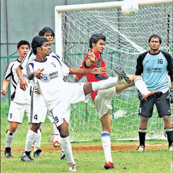 Christ University's Srikanth (third from left)  and IISC's Arka (second from right) battle for possession as Christ's goalkeeper Prashanth P (right) looks on in their  inter-collegiate football tournament clash. Dh photo