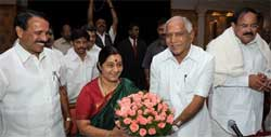 Chief Minister B S Yeddyurappa welcomes BJP leaders Sushma Swaraj, Sadananda Gowda and Venkaiah Naidu at the core committee meeting of party's state unit, in Bangalore on Wednesday. PTI