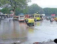 The old bus stand in Chikkaballapur is flooded due to heavy rains on Thursday evening. The traffic was affected for some time as even M G Road was flooded. dhphoto