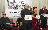 the uncommon man Governor H R Bhardwaj releasing the book - 'R K Laxman: The Uncommon Man' at Raj Bhavan in Bangalore on Thursday. Author  Dharmendra Bhandari  (extreme right), Mrs Prafullata Bhardwaj and R K Laxman  (extreme left) are also seen. DH photo