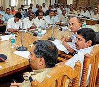 District-in-Charge Secretary M N Vidya Shankar speaking at a review meeting in Mangalore on Friday. DH photo
