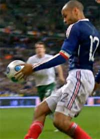TV grab shows French forward Thierry Henry controlling the ball with his palm during the World Cup qualifying football match against Republic of Ireland on Nov 18, 2009 at the Stade de France in Saint-Denis, northern Paris. The extra-time verdict came in controversial circumstances when French skipper Henry appeared to control the ball with his hand before his angled pass allowed William Gallas to head in the crucial 103rd-minute goal. AFP