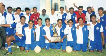 St. Joseph's College of Commerce, winners of the inter-Collegiate football tournament. STANDING (from left): Abhilash, Judy, Uma Shankar, Carlton, Pritham, Saravana (coach), Williams Joseph (sports officer), Gnanesh, Basavaraj, Muddaiah, Mervyn, Ericson. KNEELING: Sudhendra, Goverdhan, Paul, Rakesh, Bharath, Gopal, Nauman, Elangovan. DH PHOTO