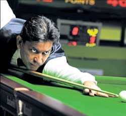 Geet Sethi prepares to strike during his victory over Kamaraj in the World Snooker Championship in Hyderabad on Friday. Sethi won 66-16, 68-1, 64-6, 52-42. AP