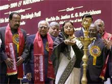 President Pratibha Devisingh Patil lights the lamp as Union Minister for Law and Justice M Veerapa Moily, Chief Justice of India K. G Balakrishnan and noted lawyer Ram Jethmalani look on, at the International Conference of Jurists-2009, in New Delhi on Saturday. PTI