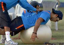 cricketer Yuvraj Singh excercises during a practice session ahead of the second test match between India and Sri Lanka in Kanpur on Sunday. PTI