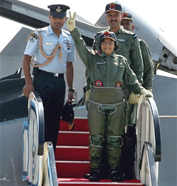 President Pratibha Patil waves after flying on a Sukhoi-30MKI of the Indian Air Force at the Lohegaon Air Force base in Pune on Wednesday. PTI