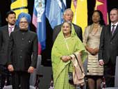 Prime Minister Manmonah Singh and his Bangladeshi counterpart Sheihk Hasina attend the opening ceremony of the Commonwealth Heads of Government Meeting in Port of Spain, Trinidad and Tobago, on Friday. AFP