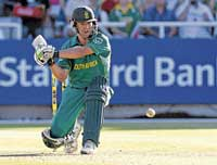 South Africa's AB de Villiers readies himself to sweep en route to his century on Friday.