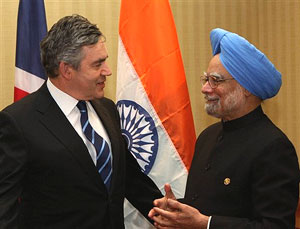 Prime Minister Manmohan Singh with his British counterpart Gordon Brown at the opening ceremony of the Commonwealth Heads of Government meeting (CHOGM) in port of Spain on Friday. PTI